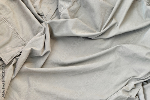 Fotografie, Obraz The texture of the fabric is olive-colored, which is similar to the uniform of A