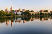 View Of The Novodevichy Monastery In Moscow On A Summer Evening From The Opposite Bank