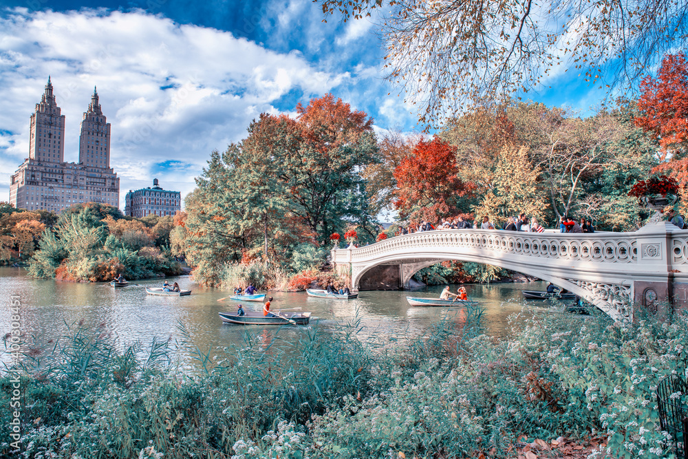 NEW YORK CITY - OCTOBER 2015: Central Park Foliage and Bow Bridge in Manhattan on a beautiful autumn day