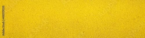 Fotografiet Yellow foam roller brush, close up