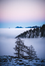 Epic Sunset With Vivid Colors In The Bavarian Mountains In Winter For Hiking With Snow Fogs And Clouds