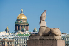 The Ancient Egyptian Sphinx, Brought To St. Petersburg In 1832, Will Erase On The Dome Of St. Isaac's Cathedral On A Sunny Summer Day. St. Petersburg, Russia