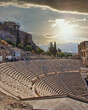 "ancient Greek theater ""Herodion"" under Acropolis of Athens and dramatic sky"
