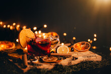 Christmas Mulled Wine, Drink With Dried Fruits And Berries, Winter Hot Tea In A Glass And Spices On A Wooden Background.