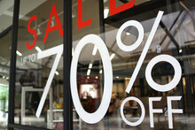 Large Sale 70% Off Letters On A Glass Wall Obstruct A View Inside The Popular Clothing Store
