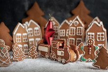 Various Christmas Gingerbread Cookies On Dark Table With Flour
