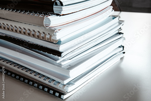 Fototapeta Stack of reports lies on a desk ready for review obraz