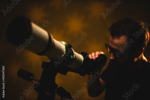 Amateur astronomer looking at the stars with a telescope Wallpaper Mural
