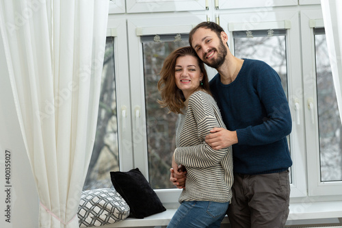 Canvas Print Romantic couple looking out of the window. Quarantine at home.