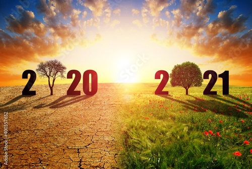 Fototapeta Number 2020 in dry country with cracked soil and 2021 in green field. Concept of Happy New Year. Global warming or change climate theme. obraz