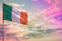 Fluttering Ireland Flag Mockup With The Space For Your Content On Colorful Cloudy Sky Background.