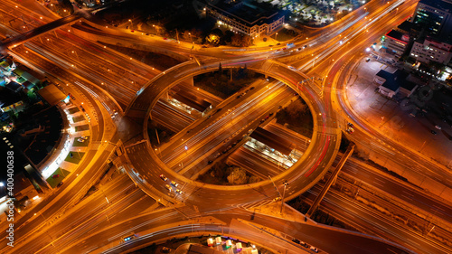 Foto Aerial drone slow shutter night photo of illuminated urban elevated toll ring ro