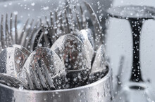 Cutlery, Forks And Spoons Are Washed In The Dishwasher, Inside View, Drops And Splashes Of Water Close-up