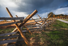 Virginia Worm Fence Or Split Rail Fence Constructed Of Wood Located At Oak Ridge On The Field Where The Battle Of Gettysburg Took Place During The Civil War, With The Eternal Light Peace Monument In T