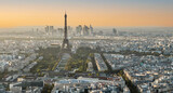 Fototapeta Paryż - Aerial view of Paris at sunset with the Eiffel tower in background
