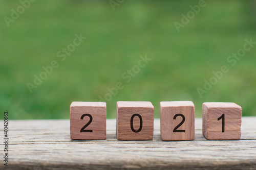 Fototapeta Number written to wooden blocks, 2021 new year card congratulation concept with copy space obraz