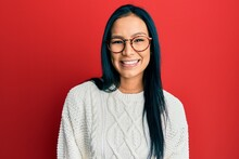 Beautiful Hispanic Woman Wearing Casual Sweater And Glasses Looking Positive And Happy Standing And Smiling With A Confident Smile Showing Teeth