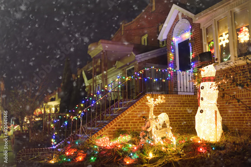 Fényképezés A street decorated for Christmas and New Year holidays in the Dyker Heights neighborhood, New York, USA