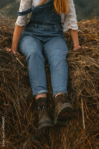 Obraz na plátně girl sitting on haystack