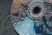Macro Shot Of Water Drops On A CD . Close Up