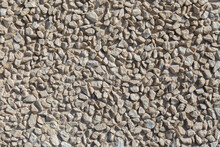 Texture Of A Beautiful Stone Wall Lined With Gravel
