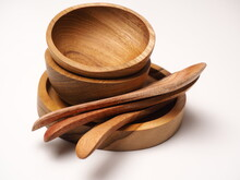 Group Of Antique Wooden Dishware That Contain Spoon, Bowl, Shoot On A White Isolated Background