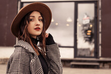 Close Up Shot Charming Woman Standing Outside Near Street Cafe Restaurant Wear Brown Hat Gray Coat Poloneck Black Sweater, Looking At The Camera. Girl Spend Time Autumn Or Spring, Cold Weather Fresh A