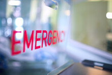 Transparent Plastic Divider On The Reception Desk In The Hospital Admission Department With Red Lettering Emergency