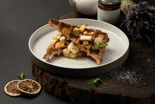 Viennese Waffles With Banana, Mango, Caramel And Mint. Classic Hot Dessert Belgian Waffles.