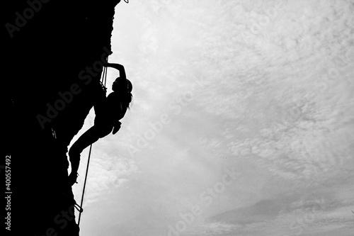 Fotografie, Obraz Yogyakarta, Indonesia - April 7, 2013: Local rock climbers do rock climbing activities on the reefs of Drini Beach, Yogyakarta, Indonesia
