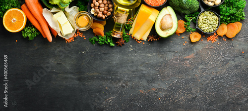 Fototapeta Set of vegetables, fruits and organic food on a dark background. Dietary healthy food. Top view. Free space for your text. obraz