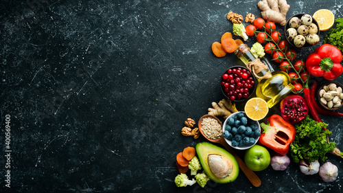 Fototapeta Healthy food for the heart. Dietary food. On a black stone background. Top view. Free copy space. obraz