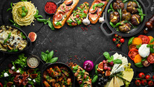 Food: Cheese, Figs, Mushrooms, Meat And Vegetables. European And Asian Cuisine. Healthy Food On A Black Stone Background. Top View.