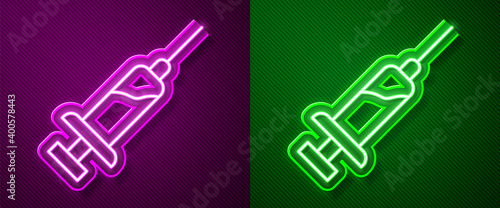 Photo Glowing neon line Syringe with serum icon isolated on purple and green background