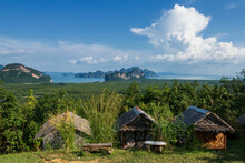 Wooden Homestay Cabin Or Hut View From Samed Nangchee Viewpoint, Phang Nga, Thailand. Beautiful Seascape Of Jame Bond Island At Antaman Sea With Blue Sky.