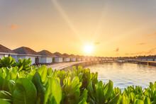 Beautiful Tropical Sunrise Over Luxury Resort Villas Seascape, Maldives