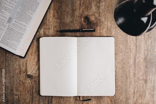 Fotografie, Obraz Blank notebook for bible study on a wooden desk