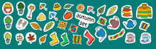 Autumn Set Sticker Pack. A Variety Of Cozy Items. Warm Clothes, Leaves Umbrella, Boots. Vector Illustration On Green Isolated Background.
