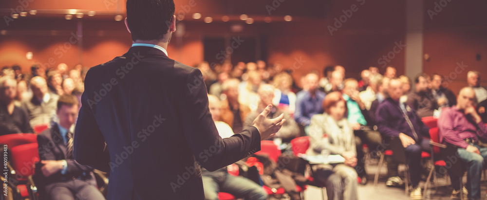 Fototapeta Speaker at Business Conference and Presentation. Audience at the conference hall.