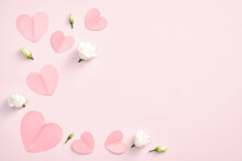 Happy Valentines Day Concept. Flat Lay Paper Hearts And White Rose Flowers On Pink Background. Top View With Copy Space.
