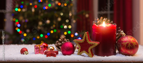 Obraz Christmas red candle with decorations and fir tree isolated on lights background. - fototapety do salonu