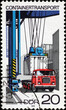 Container loaded on a truck on old stamp