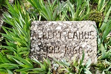Grave Of Albert Camus In Lourmarin, Provence, France. The Nobel-Prize-winning Author Of The Stranger, The Plague, And The Fall Is Buried Beneath A Simple Stone Gravestone In A Sleepy French Village.