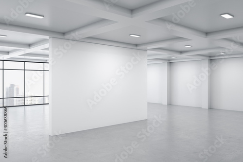 Bright gallery interior with city view, daylight and blank wall. Fototapet