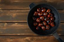 Chestnuts On Dark Wooden Surface
