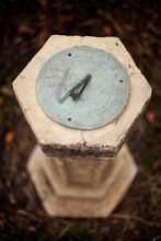 Beautiful Antique Sun Dial Made Of Copper And Sitting On A Stone Plinth