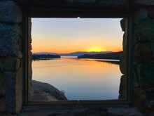 Stone Window To A Sunrise Over The Bay And Mountains