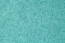Blue Fluffy Background Of Soft, Fleecy Cloth. Texture Of Turquoise Wool Textile.