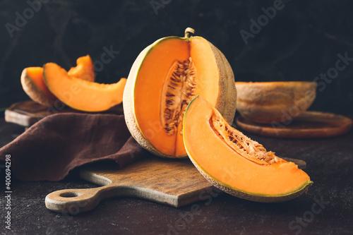 Sweet cut melon on table Fotobehang