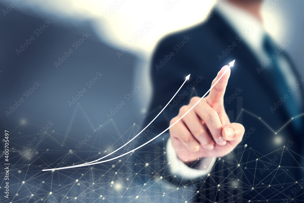 Fototapeta Development and growth concept. Businessman plan graph stock of growth and increase of positive indicators in his business 2021.